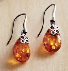 Amber Drop Earrings: Amber is the star. The simple setting for this jewelry set makes the amber drop a dramatic focal point. Cognac amber is set in brushed oxidized sterling silver accents.  Made in Poland. Amber jewelry can be found in the museum's collection.