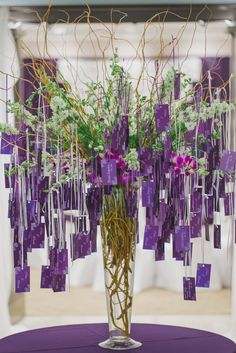 Hanging Escort Card Display With Curly Willow | Photo: Soltren Photography |