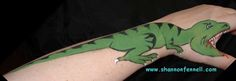 Dinosaur hand/arm painting. Less creepy and less hassle than face painting? (This one's a little gory.)