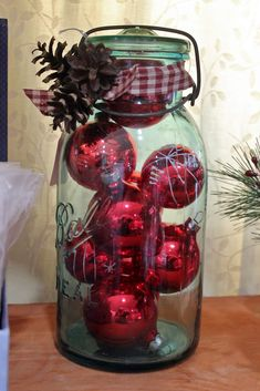 vintage canning jar filled with vintage Christmas glass balls & decorated with gingham ribbon + greenery