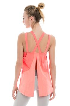 This Lolë tank top's got your back with its four-way stretch, moisture-wicking fabric, sexy straps and demure back slit. Tie it up while you workout and leave it loose when you cool down. Low-support inner bra &bu