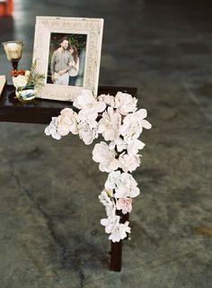 airplane-wedding-reception-decor-white-flower-photo-frame