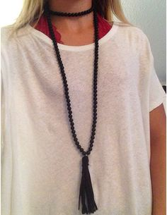 matte black beads with leather tassel