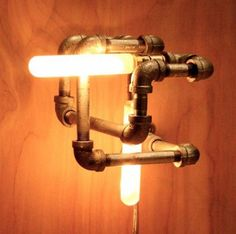 Plumbing Pipe Lights #HandmadeFurniture >> See more great DIY ideas at http://wiselygreen.com/15-industrial-pipe-furniture-and-home-projects-for-diyers/