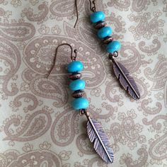 Turquoise and copper feather earring by MomentsofChaos on Etsy