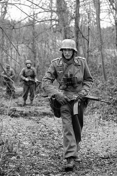 "This German soldier carries the Sturmgewehr 44, the first ""assault"" (battle) rifle to come into mass production. The StG 44 was far superior to anything the Allies had to deploy, but endemic industrial shortages prevented its full implementation throughout the German army. In the end, its appearance in the battlefield came too late to influence the outcome of the conflict."