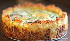 Spinach and Gruyere Cheese Quiche with a Hash Brown Crust - Eggs, spinach, onions and peppers and nutty glorious Gruyere cheese all nestled in a hash brown crust.  What's not to like?