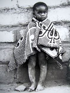 Boy with heirloom blanket in the Tribal Basotho tradition.