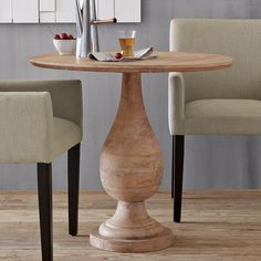 Turned Pedestal Bistro Table. Crafted from Mango wood, traditional Turned Base. By westelm.com