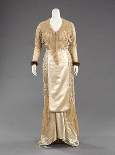 Jacques Doucet, Evening Dress of Cream Figured Silk with Bodice Drop of Sheer Lace. Paris, c. 1910.