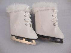 Pair of Ice Skates for the 18 Inch Doll Made for the American Girl Doll by Olivia's Doll Closet, http://www.amazon.com/dp/B003QUPH3G/ref=cm_sw_r_pi_dp_i8mwrb0KG1JM4