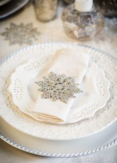 For your winter soiree, dress up white plates with some glamorous embellishments.