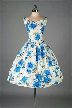 Cute vintage dress. White with blue flowers