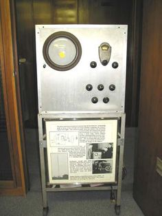"""In 1932 this television set was built by the engineering department of Purdue University and was one of """"the first to add synchronizing pulses to their transmissions."""" This experimental set had a reception of 60 mechanical transmissions and was created for the use of the University's station """"W9XG."""" Being one of the first electronic TV receivers Purdue's engineering department worked to advance the TV. As seen in the picture it is equipped with a circular screen and controllable transmission..."""