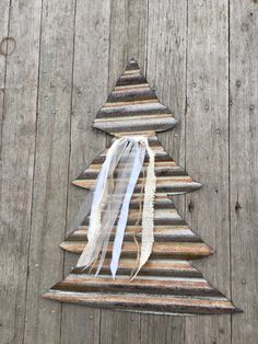 """These Christmas trees are hand cut from old salvaged tin.  Fabric strips and silver ribbons are added to give them a elegant yet rustic shabby look.  They would be beautiful on your door, barn, wall or anywhere indoors or out!    They measure 20"""" wide at the base and 15"""" tall.  They are pre hung with a hidden wire hanger.    Please note that I cut all of my items from salvaged tin.  Each piece may contain nail holes, rust or tears making each piece perfectly imperfect!  Cut tin has sharp…"""