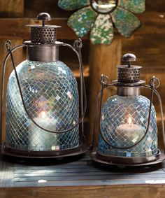 On a covered patio by the garden, thanks #zulily! Teal Mosaic Glass Lantern Set #zulilyfinds