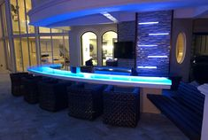 "Outside bar in Florida with CBD glass countertop. Glass shown in Ultra Clear glass 1 thick, with our signature ""melting ice"" texture and RGB light. Glass Bar, Clear Glass, Bar Countertops, Ice Texture, Outside Bars, Pool Ideas, Bar Ideas, Glass Design, Colored Glass"