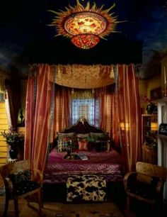 Note ceiling light and decoration. Shimmering pinks and oranges and rich, dark blue.