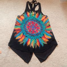 Lightweight feather top Polyester, slightly sheer,  racerback tank top with colorful feather design on front. High-low hem comes down to the hip and thigh. Slight fray on one strap, not noticeable when worn. Size small can also fit medium. Ali & Kris Tops