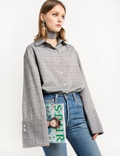 Grey check print oversize sleeve shirt with wide sleeve cuff. Comes with optional neck tie. Estimated arrival Jan 25- Feb 4, 2017USE 15% OFF CODE PREORDER at checkoutPre-orders can only be shipped within the continental US. Arrival date is not guaranteed *90% polyester, 10% rayon *Made by us*Fits is oversize*Model's height is 5'9