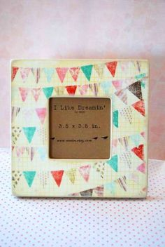 I LOVE her frames. I would like one of each.    Party Bunting Frame by Mmim on Etsy