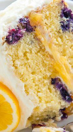 Ultimate Lemon Blueberry Cake ~ Supremely moist and flavorful Lemon Blueberry Cake slathered with homemade Lemon Frosting. This is the ULTIMATE Lemon Blueberry Cake! Blueberry Cake, Blueberry Recipes, Cake Recipes, Dessert Recipes, Lemon Recipes, Summer Recipes, Cupcake Cakes, Cupcakes, Poke Cakes
