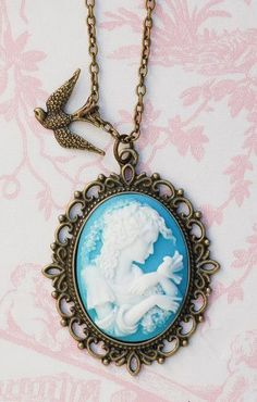 Blue Cameo Pendant Bird Necklace-love the atypical cameo color and bird accent just want a shiny gold frame and chain to mod this up!