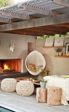 Comfortable seating area in the garden with a fireplace and hanging chair.-Gemütlicher Sitzbereich im Garten mit Kamin und Hängesessel. Noch mehr Ideen g… Comfortable seating area in the garden with a fireplace and hanging chair. More ideas … - Patio Interior, Interior And Exterior, Modern Interior, Outdoor Rooms, Outdoor Living, Outdoor Seating, Outdoor Lounge, Indoor Outdoor, Terrasse Design