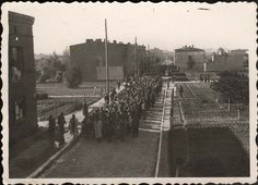 Lodz, Poland, Deportees walking toward the Rodergast Station during deportation. Walking to their untimely and sad death