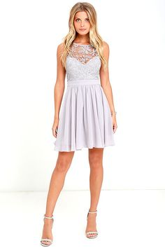 You can't help but hum a happy tune when you take a twirl in the Jolly Song Grey Lace Skater Dress! Elegant crocheted lace tops a sweetheart silhouette atop a lightly padded bodice with darted detail. Lovely woven fabric falls from a banded waist into a flirty skater skirt. Three hook clasps join above an open back. Hidden back zipper with clasp.