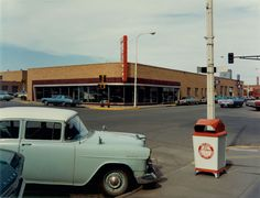 Stephen Shore (American, b. 1947): Intersection: Main Street and Second Avenue, Valley City, North Dakota, July 12, 1973 Chromogenic contact print, 6 ¼ x 8 1/8 inches (15.8 x 20.6 cm). Printed 1974.