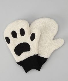 Transform little fingers into fuzzy-wuzzy paws by pulling on these silly gloves. The playfully detailed mittens feature ribbed cuffs that keep heat in and moisture out.   45% cotton / 45% polyester / 10% nylonMachine wash; hang dry