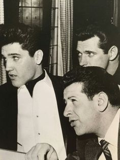 Elvis, Joe Esposito, and Charlie Hodge on the train in 1960.