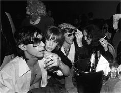 Iggy Pop, Cyrinda Foxe, David Bowie, and Lisa Robinson ( Nancy Spungen in the background!)