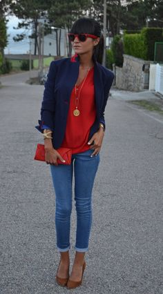 Navy blazer, red shirt, and gold pendant
