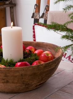 Wood bowl takes centre stage in this lovely display, apples - white candle.