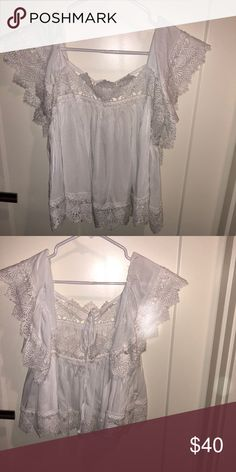 White lace shirt Moon River white float lace shirt. There is lace on the bottom, top and the sleeves. Ties in the back moon river Tops