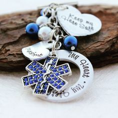 """Perfect Keychain to show your love for your EMT or Paramedic! Great for any EMT Wife, Paramedic Girlfriend, or Mom. This hand stamped pendants read """"My Heart . My Hero . My EMT"""" EMT can be changed to"""