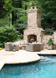 Outdoor pool patio fireplace. Outdoor fireplace placed on pool patio. Pool patio…