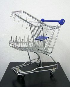 This picture is showing us how brand name products and shopping centers are always hungry for more money and more consumerism.  http://www.merriam-webster.com/dictionary/consumerism