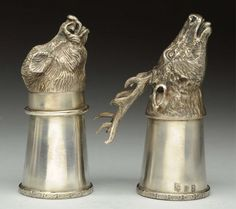 "A Russian figural silver boar head vodka stirrup cup. Silversmith: A.K 1867 Kamenetz Podolsk (Ukraine). 84 silver. Weight: 3.6 oz. And an Imperial Russian silver figural 10 point buck vodka stirrup cup. Silversmith: A.K 1867 Kamenetz Podolsk(Ukraine). Weight: 5.4 oz. Largest : 4"" L. Condition (Very Good)."