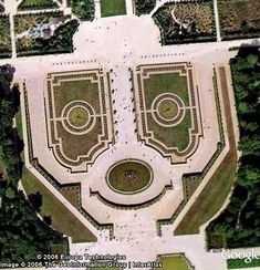 Smiley face hidden in the grounds of the Château de Versailles as seen by Google Earth.