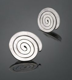 Alexander Calder 1898 - 1976 EARRINGS silver wire, in 2 parts Each: 3/4 by 3/4 by 1/2 in. 1.9 by 1.9 by 1.3 cm.