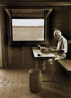 E. B.White, author of 'Charlotte's Web', 'The Trumpet of the Swan', and 'Stuart Little', writing in his boathouse.