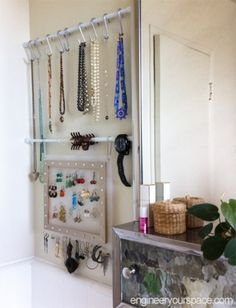 Small bathroom jewelry storage with tension rods