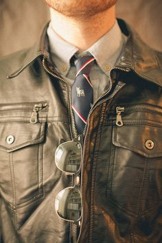 Fall Trend = Leather! Great 40's jacket with a skinny club striped tie. Do you have a pair of aviator glasses that would complete this look?