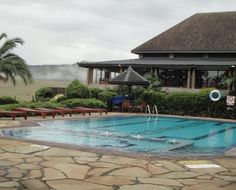 Lake Nakuru Lodge- is situated on a hilltop in the south east corner of Lake Nakuru National Park with commanding views over the lake. The Lodge blends in with it's surroundings and animals often graze peacefully close to the Lodge precincts. Lake Nakuru National Park is the Bird watchers Paradise, as well as a Rhino Sanctuary. This is a great place to be for the bird lovers. The lodge provides 68 rooms and cottages with 136 beds.