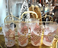 Set of six frosted pink and gold tall glasses and glass caddy.