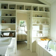 love the cottage feel. great shelving and love the barn door/sliding door to the bedroom.