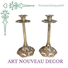 Antique Art Nouveau Candlesticks with ornate open work design.  True to period a great find your period decor.  Visit our shop for these beauties and a wide variety of home decor items from every genre.